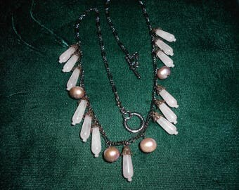 Rose quartz and freshwater pearl necklace with an antique look to it.