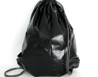 Black vinyl  waterproof drawstring bag backpack with lining and zipper pocket Unique