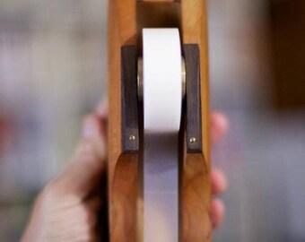 Craft adhesive tape dispenser in precious woods.