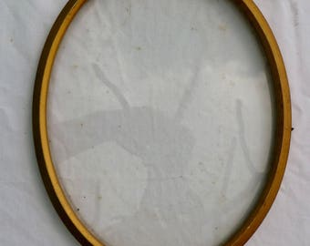 vintage oval frame with glass