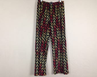 White n red flame pants size S