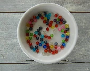 Set of 90 translucent multi-colored beads