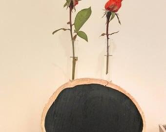 Slice of driftwood, vase, glass test tube