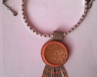 Orange designer necklace with ceramic cabochon setting
