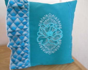 cushion has embroidered wheel