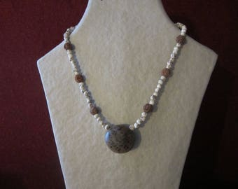 Necklace natural donkey eye, blue seed and royal Palm