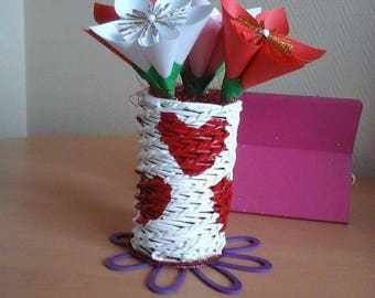 Plant pot with c is red and white origami flower