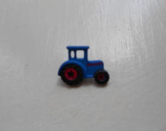 Decorative button, blue tractor shape