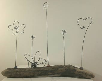 Put pics in annealed iron wire, ceramic beads support drift wood