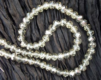 Pearls of Swarovski Crystal: 6 x 8 mm iridescent grey (x 5)