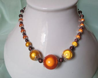 Pretty as a dessert chocolate with a zest of orange and lemon... This necklace!