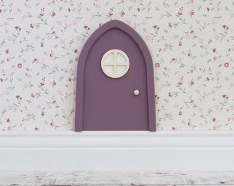 Purple Fairy door made of wood