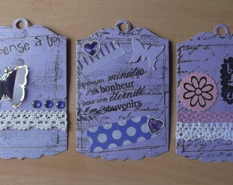 3 purple tags for your scrapbooking creations.