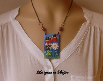 Short necklace/table made of polymer clay representing a garden with flowers and butterflies