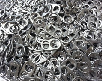 1100 capsules sorted washed cans sorted silver rounded hole - identical capsules - washed-