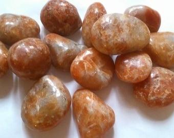approximately 3 cm 1 rolled orange calcite stone