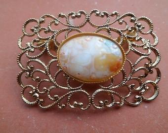 Gold filigree brooch Center China