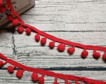 2 x m ribbons/trims 15 red tassels