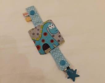 Attache-tétine en tissus avec pression et attache type bretelle - tissus bleu à pois blanc, motif dinosaure
