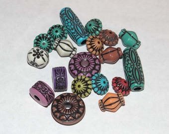 set of 19 different colors and sizes plastic beads see photo