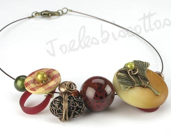 Button necklace on wire with ceramic beads intermingled metal bead, wood, leaf charm Ginkgo, wholesale
