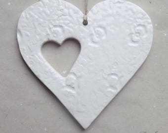 Large white heart in earthenware openwork and lace impressions