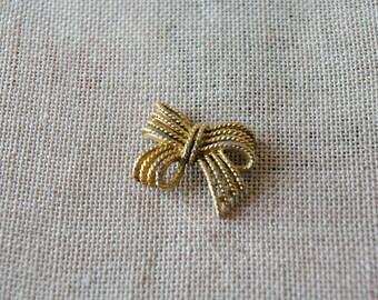 Vintage gold metal bow pendant charm