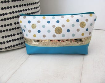 Purse with turquoise faux leather makeup and dots pattern