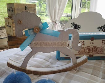 Horse on distressed white wood swing
