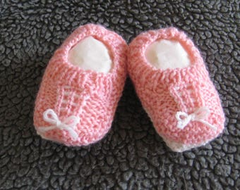 Hand knitted baby booties - salmon with white trim