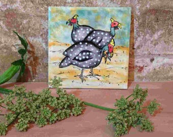 Ceramic tile with guinea fowl painted