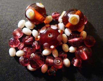 45 Indian pink, amber, white glass beads
