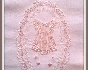 Medallion with embroidered corset