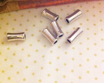 10 spacer beads silver curved tube, length 11.5 mm