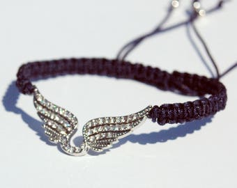 Macrame bracelet black wire and charm pair of wings with multitude of rhinestones