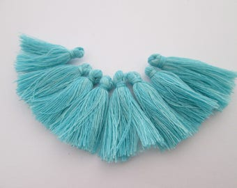 8 pompons en fils de coton longueur 3 cm couleur : bleu turquoise