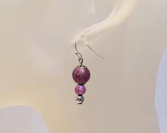 2 purple glitter beads earrings
