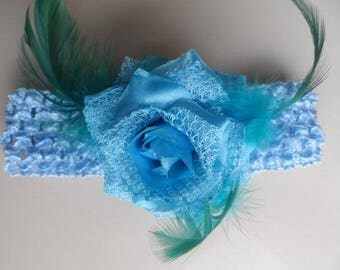 Blue elastic headband with flower embellishment