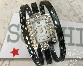 Ladies watch SIZE. S. Rectangular watch in silver metal and rhinestone Black strap with silver keys magnetic clasp
