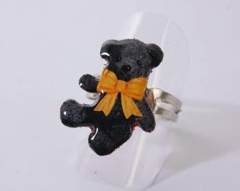 Ring bear plush, black and yellow