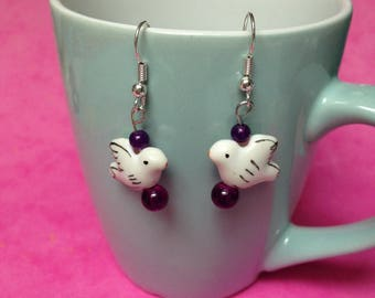 pair of porcelain bird and purple beads earrings