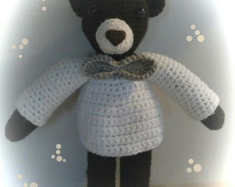 Polar bear cub and crocheted clothes.