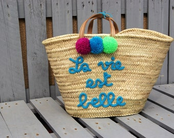 Personalized Tote knitting with tassels and leather handles.