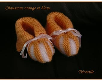 Orange and white booties