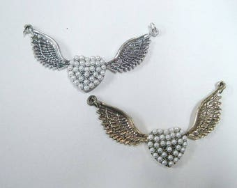 hearts with wings charms.
