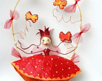 Red and yellow little Queen hanging mobile