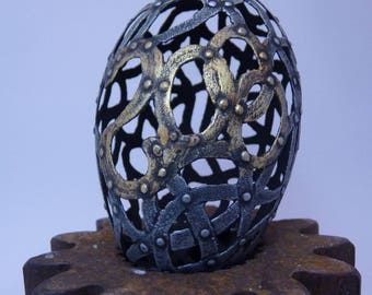 The Year 2000 Egg, carvedgoose eggshell with aged metal patina