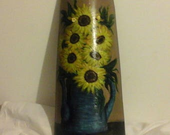 Tile handpainted sunflowers in a blue pitcher