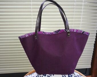Purple linen tote bag-shaped basket.