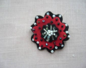 Red and black flower hand made felt brooch embroidered with seed beads
